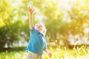 Little boy with soap bubbles